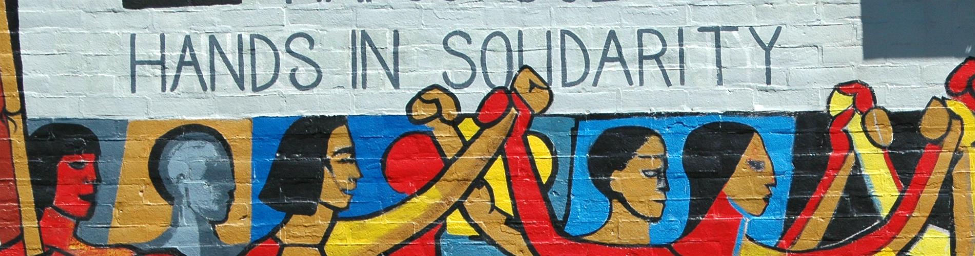 Photograph of the 'Hands in Solidarity, Hands of Freedom' mural on the walls of a trade union building in Chicago, U.S.A.