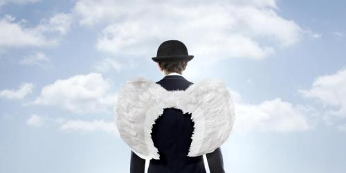 Businessman with angel wings, a business angel.